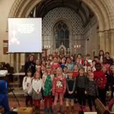 AKPS Choir Shine Brightly at the Christingle Service